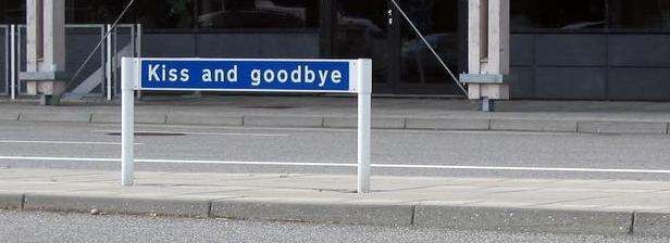 Kiss and Goodbye sign at the Aalborg airport, Denmark, 2005